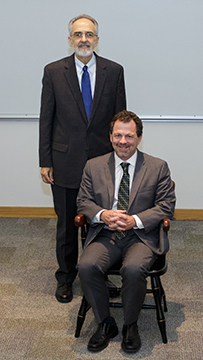 Dean Michael G. Perri and Dr. Glenn E. Smith. Faculty honorees receive a chair to represent their endowed professorship or chair.